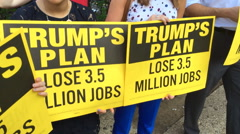 Protesters say Donald Trump outsources American jobs Stock Footage