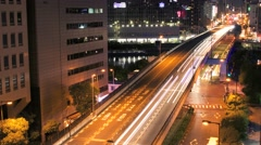 Night view of cars crossing a bridge in Osaka, Japan. Stock Footage
