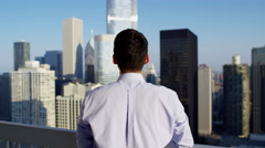 Successful Asian American male business consultant on downtown city rooftop Stock Footage
