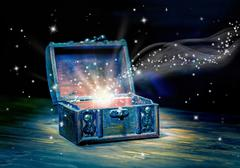 Concept greeting card of opened chest treasure with mystical miracle light on Stock Photos