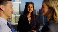 Multi ethnic business people talking strategy overlooking cityscape Chicago Stock Footage