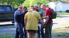 Family Stands and Prays at Flood Damaged House in West Virginia Stock Footage
