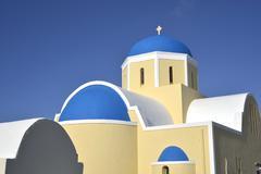 Yellow blue church at Oia Santorini Stock Photos