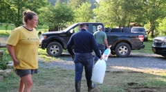 Volunteers Carry Ice Truck for Flood Victims Stock Footage