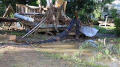 Exterior Shot on Homes of Flood Damage with Standing Water in Yard - stock footage