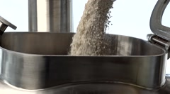 Raw material pours into the tank Stock Footage