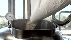 Grain pours into the tank in the process of beer production Stock Footage