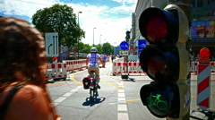 Roadworks Commuter Biker Bicycle zebracross crosswalk traffic light barrier - stock footage
