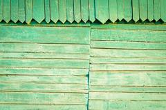 Old faded green wood with joins and traingle shaped carved details. Copy spac Stock Photos