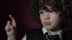 4k Shot of a Cute Businessman Child Clicking on Invisible Button (close-up) Stock Footage