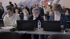 Journalists working on their laptops at the international economic forum. News Stock Footage