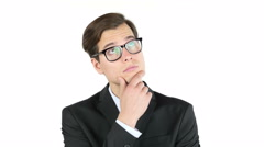 Serious business man thinking, isolated on white background Stock Footage