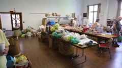 Relief Supplies on Tables in Church to Serve Flood Victims Stock Footage
