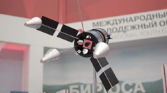 Space satellite model at the international youth educational forum. NASA Space d Stock Footage