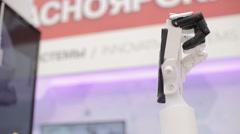 Biomechanical hand at the exhibition tehnicheskh scientific achievements. Prosth Stock Footage