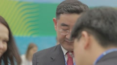 Adult Asian man standing and talking with his interlocutors. Mezhzhdunarodny eco - stock footage