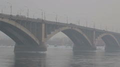 Road bridge over a river in winter Russia. Siberian frost. River covered with ic Stock Footage