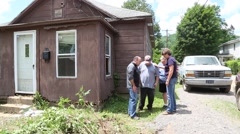 Man Prays with Family at Flood Damaged Home in WV 2016 Stock Footage