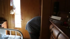 Man in Mask Removes Goods from Flood Damaged House Stock Footage