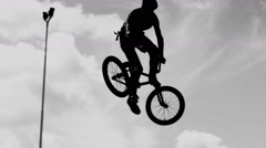 Silhouette of bicycle jumper. Stock Footage