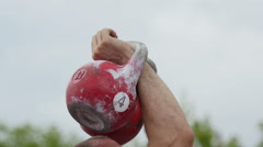 Fit people lifting kettlebells together Stock Footage