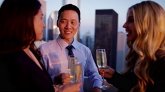 Multi ethnic business people celebrating success on sunset rooftop Stock Footage