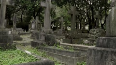 Camera moving through cross gravestones at the old christian cemetry. - stock footage