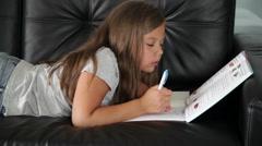 School girl is doing homework Stock Footage