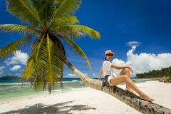 Relaxing On Palmtree - stock photo