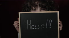4k Shot of a Cute Businessman Child showing Hello sign on a Board - stock footage