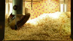A close up of a popcorn machine filled with fresh popcorn in a cinema. Stock Footage