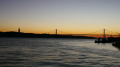 Sunset view of The 25 de Abril Bridge in Lisbon, Portugal, panorama Stock Footage