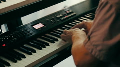 Man playing the electronic piano keyboard. Stock Footage