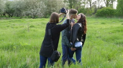 Female photographer shooting lovestory with young couple Stock Footage