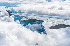 Looking through window airplane during flight in wing Stock Photos