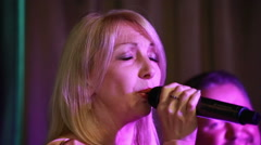 Woman singer and saxophone man, vocal band. - stock footage