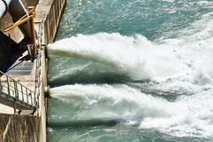 Discharge water from dam in the Alps Stock Photos