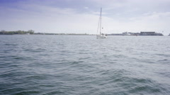 Keel boat sailing on Ontario lake in Toronto harbour in sunny day Stock Footage