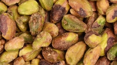 Zoom out shot on pine nuts Stock Footage