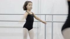 Dance of little balerina. Ballerina shows classic ballet pas - stock footage