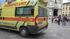 Ambulance passes Piazza del Duomo, Florence, Italy Stock Footage