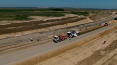 Construction of highways . Road construction machinery . Aerial view - stock footage