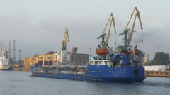 The port , Russia: work in the port, a large cargo ship, the ship in the Stock Footage