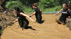 Extreme sport challenge jump in muddy water - stock footage