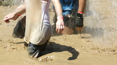 Extreme sport challenge jump in mud water - stock footage