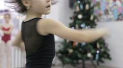 Dance of balerina. Ballerina shows ballet pas. on background of Christmas tree - stock footage