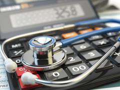 Health care costs concept. Stethoscope and calculator  of medical insurance. - stock illustration
