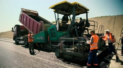 Road Workers are laying New Asphalt on the Road Construction Stock Footage