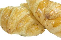 Single Butter Croissant isolated on white - clipping path included - stock photo