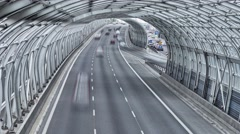 Modern tunnel above highway in Warsaw. Time lapse footage of highway. Stock Footage